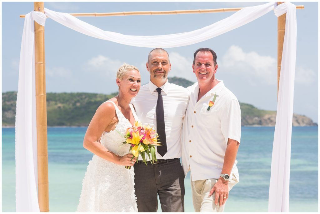 beach wedding with couple and minister