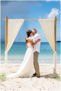 bride and groom kissing at their wedding on the island
